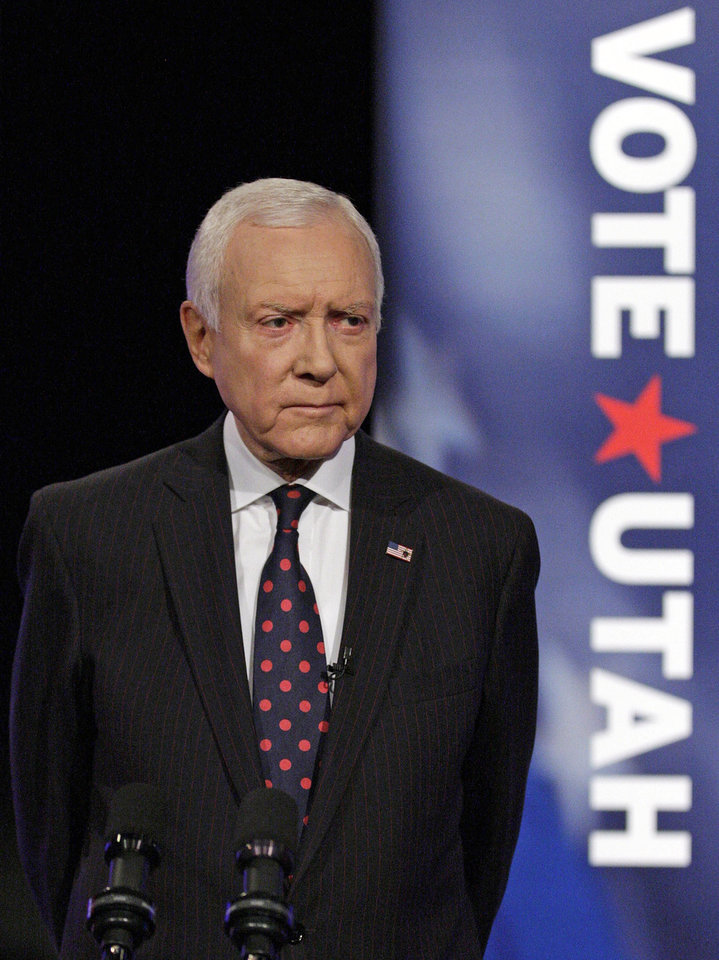 Photo - FILE - This Oct. 17, 2012, file photo, shows U.S. Senator Orrin Hatch, R-Utah, looking on before the start of the VoteUtah 2012 U.S. Senate Debate, in Provo, Utah. Utah's two Republican senators have had mixed reactions to the comprehensive immigration bill introduced last week in the U.S. Senate. Sen. Orrin Hatch helped hammer out an agreement for agriculture workers under the bill and says he wants to support the measure but has some concerns. But Sen. Mike Lee says he can't support the bill as long as it includes a path to citizenship for the estimated 11 million immigrants living in the country illegally. (AP Photo/Rick Bowmer, File)