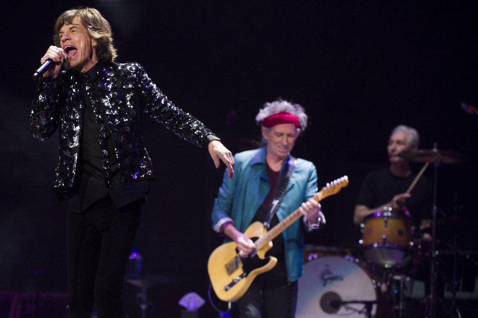 Mick Jagger, from left, Keith Richards and Charlie Watts of The Rolling Stones perform in concert on Saturday, Dec. 8, 2012 in New York. (Photo by Charles Sykes/Invision/AP)