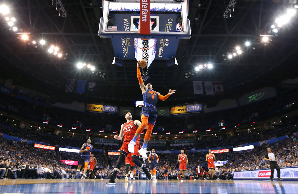 Photo - Oklahoma City's Russell Westbrook (0) in front of Toronto's Marc Gasol (33) goes up for a lay up during the NBA basketball game between the Oklahoma City Thunder and the Toronto Raptors at the Chesapeake Energy Arena, Wednesday,March 20, 2019. Photo by Sarah Phipps, The Oklahoman