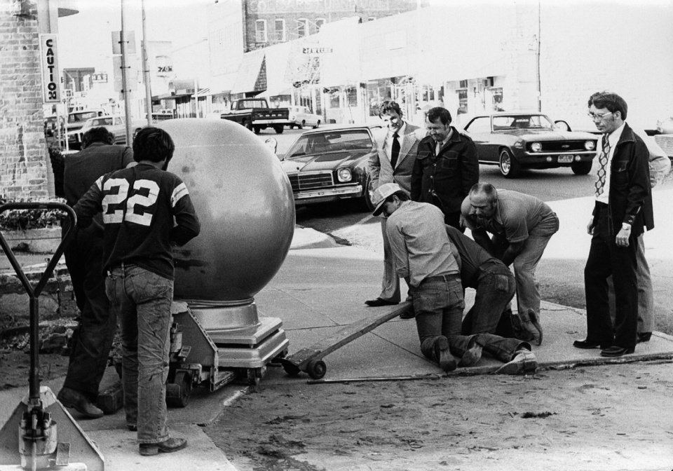 Photo - In this archive photo, workers move a bank vault at the Union Bank of Chandler as part of the bank's move to a new building in 1976.  PROVIDED