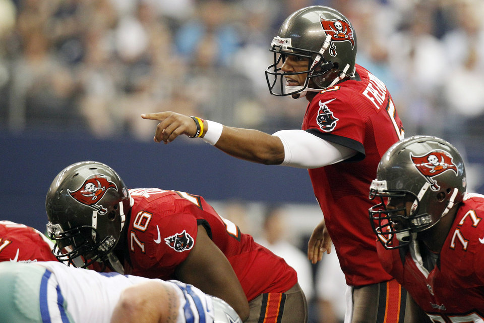 Tampa Bay Buccaneers quarterback Josh Freeman (5) calls a play against the Dallas Cowboys during the first half of an NFL football game, Sunday, Sept. 23, 2012, in Arlington, Texas. (AP Photo/LM Otero)