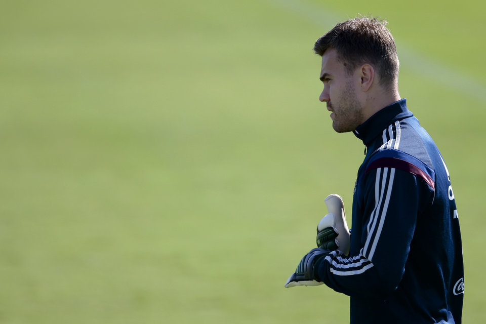 Photo - Goalkeeper Igor Akinfeev looks at a ball during Russian national soccer team training session in Itu, Brazil, on Thursday, June 19, 2014. Russia will play next game against Belgium in group H of the 2014 soccer World Cup. (AP Photo/Ivan Sekretarev)