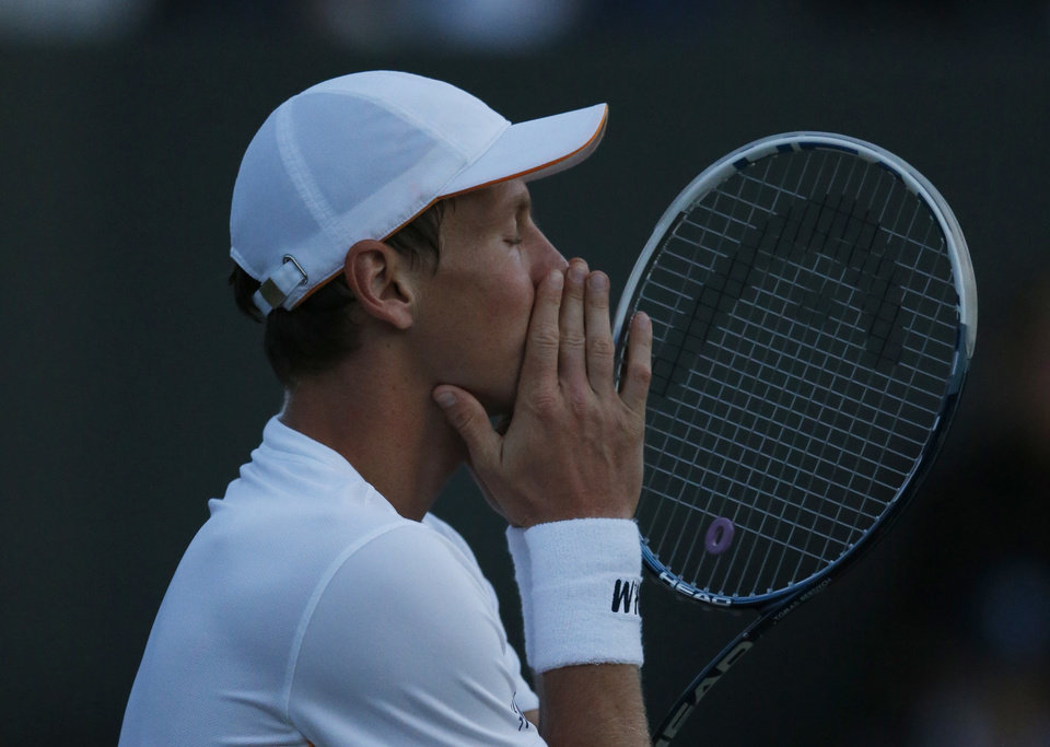 Photo - Tomas Berdych of Czech Republic complains to the umpire about the fading light conditions during the men's singles match against Marin Cilic of Croatia at the All England Lawn Tennis Championships in Wimbledon, London, Friday June 27, 2014. (AP Photo/Ben Curtis)