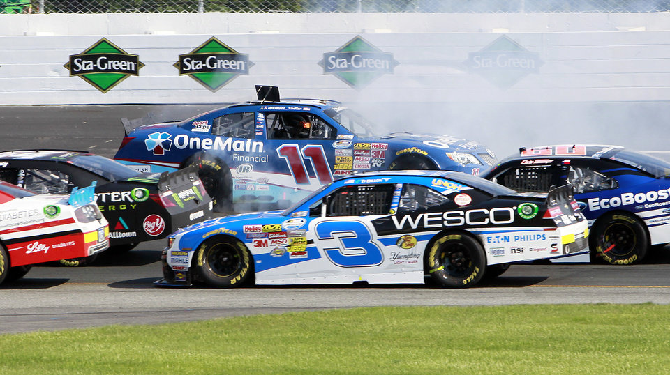 Photo - Elliott Sadler (11) spins out during the NASCAR Nationwide Series auto race at New Hampshire Motor Speedway Saturday, July 12, 2014, in Loudon, N.H. (AP Photo/Jim Cole)
