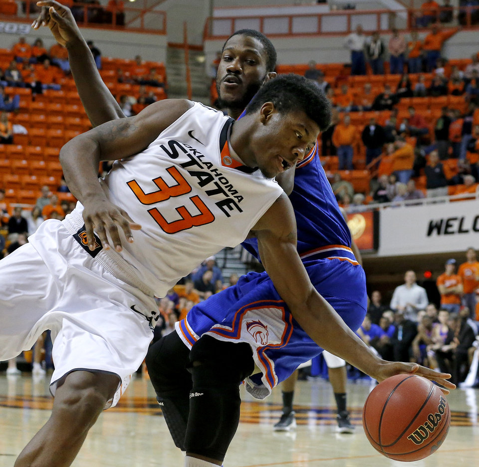 Photo - /tou33n/ goes past Texas-Arlington's Kevin Butler (24) during a college basketball game between Oklahoma State University and UT Arlington at Gallagher-Iba Arena in Stillwater, Okla., Wednesday, Dec. 19, 2012. Photo by Bryan Terry, The Oklahoman