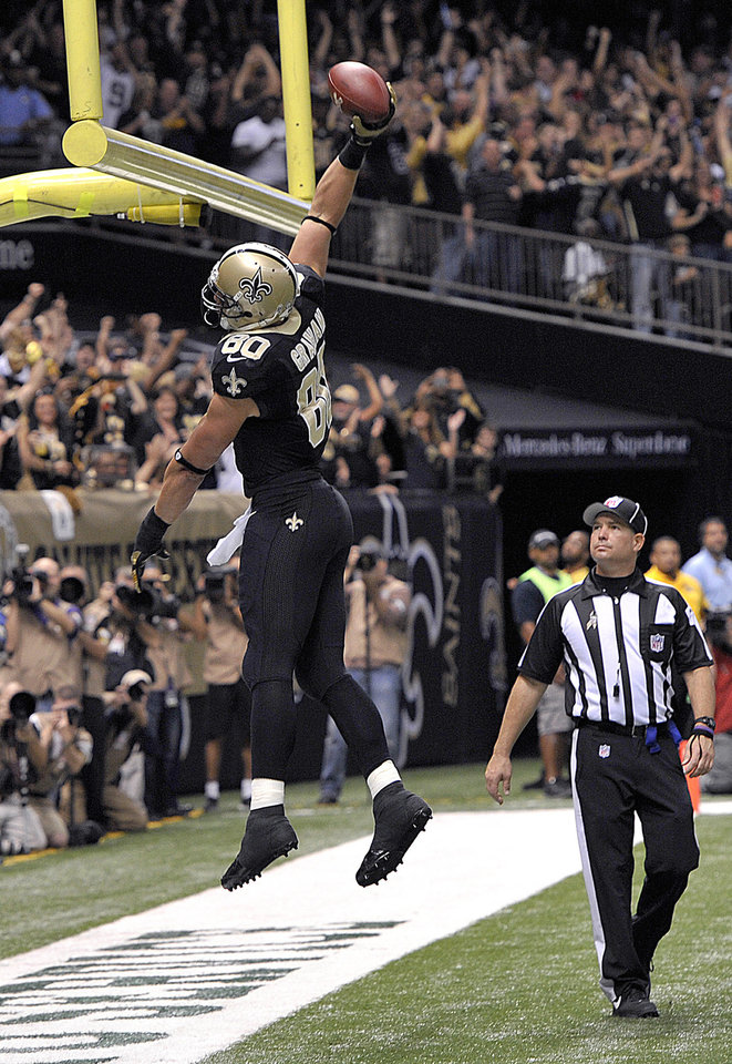 Photo -   New Orleans Saints tight end Jimmy Graham (80) celebrates his touchdown reception in the first half an NFL football game at the Mercedes-Benz Superdome in New Orleans, Sunday, Nov. 11, 2012. (AP Photo/Bill Feig)