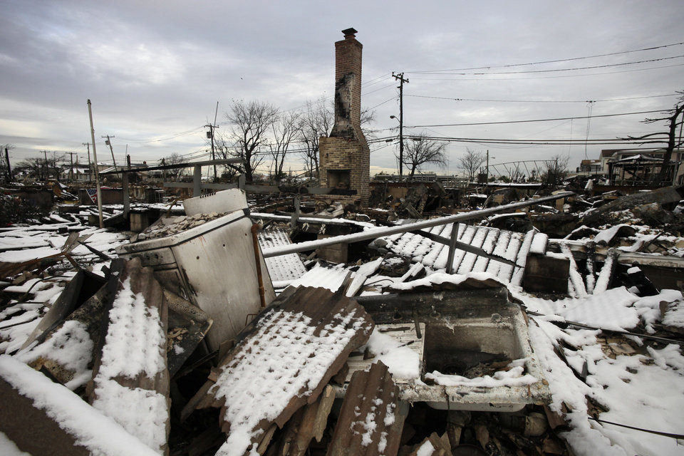A fire-scorched landscape of Breezy Point is shown after a Nor\'easter snow, Thursday, Nov. 8, 2012 in New York. The beachfront neighborhood was devastated during Superstorm Sandy when a fire pushed by the raging winds destroyed many homes. (AP Photo/Mark Lennihan) ORG XMIT: NYML105