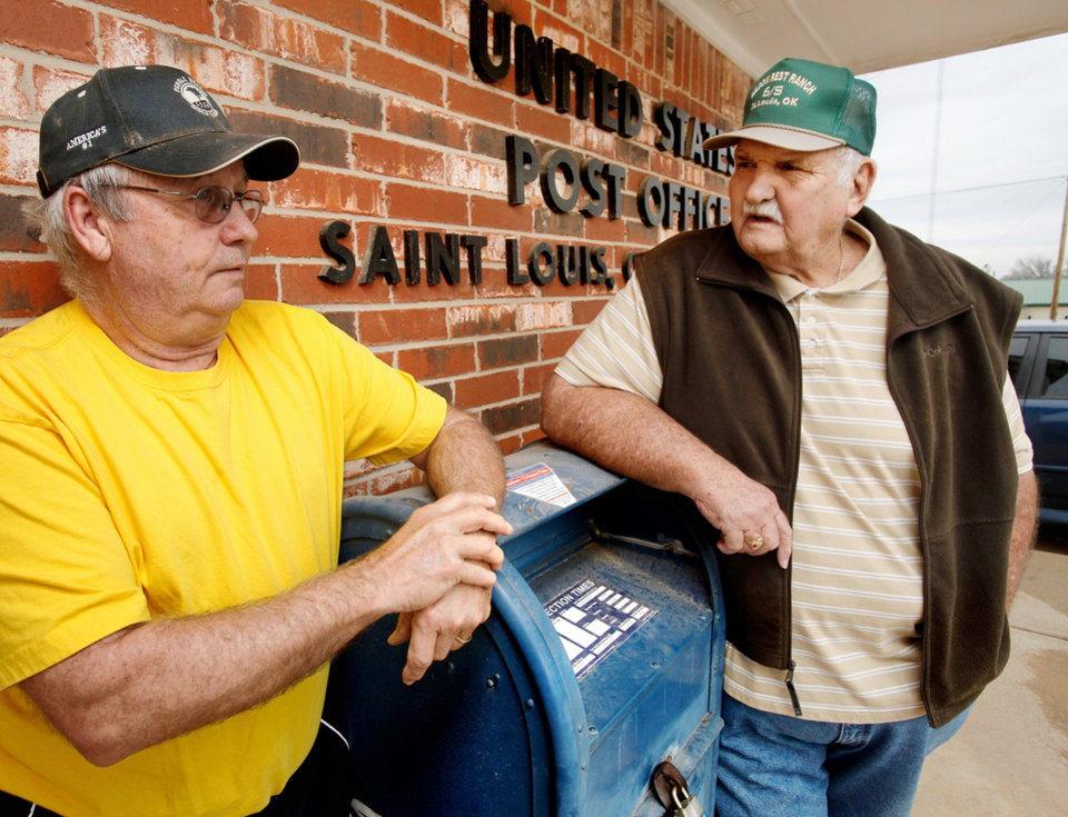 Paul Allen, 65,  left, and Bill Sullivan, 79, in front of the United States Post  Office in the tiny Pottawatomie community of St. Louis, on Monday, Dec. 19, 2011.  This post office is included on a list released recently of postal facilities  being considered for closing. Photo by Jim Beckel, The Oklahoman