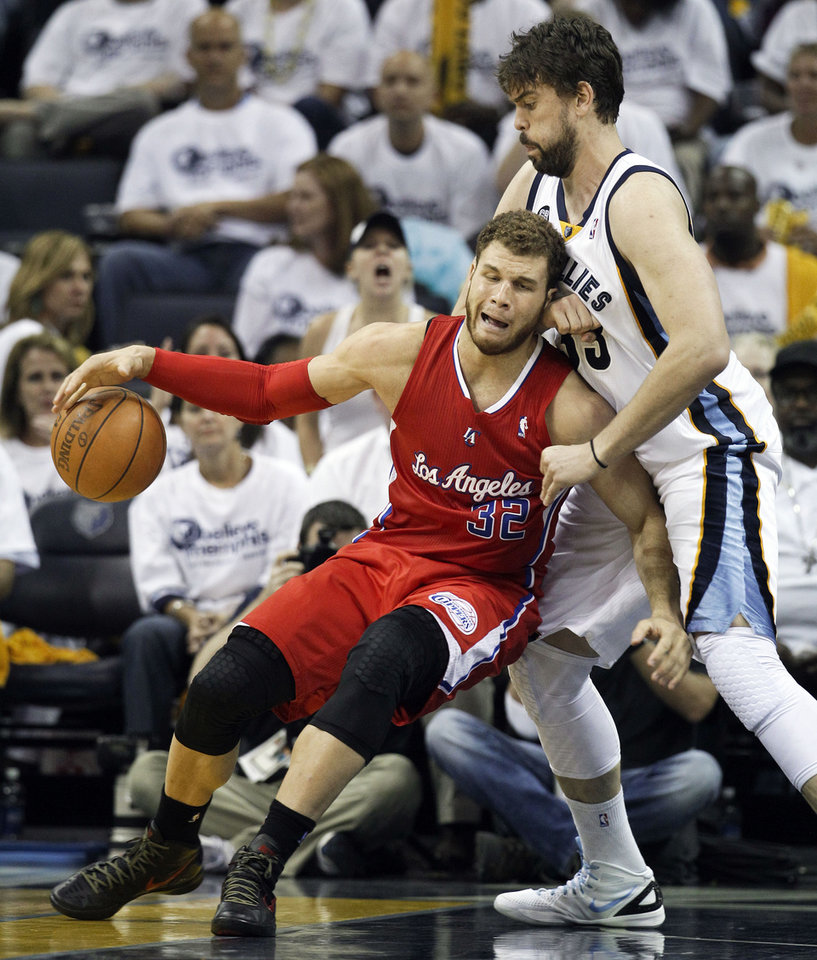 Photo -   Memphis Grizzlies center Marc Gasol, of Spain, right, blocks the path of Los Angeles Clippers forward Blake Griffin (32) during the second half of Game 5 of a first-round NBA basketball playoff series on Wednesday, May 9, 2012, in Memphis, Tenn. (AP Photo/Mark Humphrey)