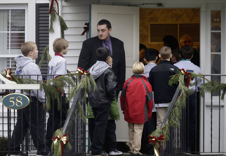 Mourners arrive for the funeral service of Sandy Hook Elementary School shooting victim, Jack Pinto, 6,  Monday, Dec. 17, 2012, in Newtown, Conn. A gunman walked into Sandy Hook Elementary School in Newtown Friday and opened fire, killing 26 people, including 20 children. (AP Photo/David Goldman)