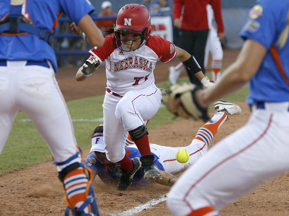 Nebraska's Gabby Banda runs home to score past Florida's Stephanie Tofft as she drops the ball in the seventh inning of their Women's College World Series softball game at ASA Hall of Fame Stadium in Oklahoma City, Saturday, June, 1, 2013. Photo by Bryan Terry, The Oklahoman