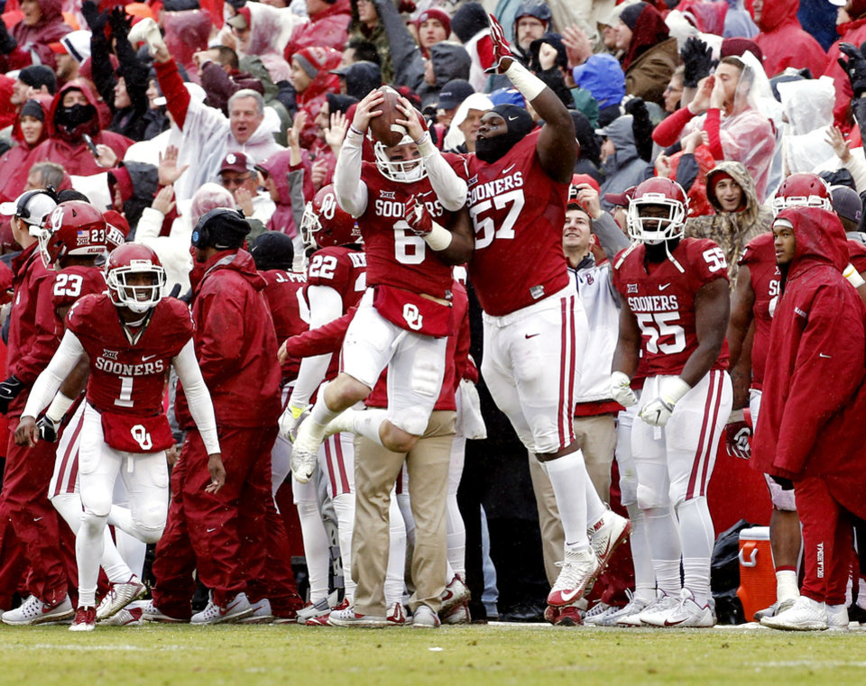 Photo - Oklahoma's Baker Mayfield (6) brings the ball he handed to Joe Mixon (25) for a 79 yard touchdown to the bench and celebrates with Du'Vonta Lampkin (57) during the second half of the Bedlam college football game between the Oklahoma Sooners (OU) and the Oklahoma State Cowboys (OSU) at Gaylord Family - Oklahoma Memorial Stadium in Norman, Okla., Saturday, Dec. 3, 2016. Photo by Steve Sisney, The Oklahoman