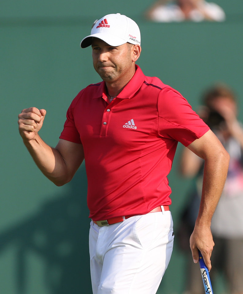 Photo - Sergio Garcia of Spain celebrates on the 18th green after finishing his round on the second day of the British Open Golf championship at the Royal Liverpool golf club, Hoylake, England, Friday July 18, 2014. (AP Photo/Peter Morrison)