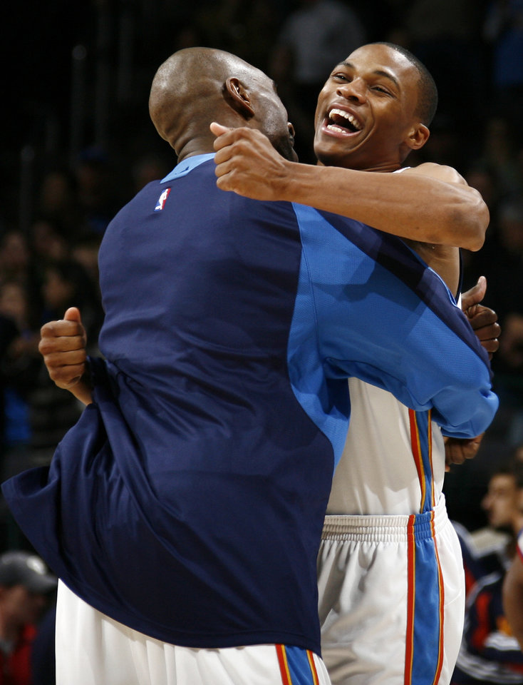 Photo - Oklahoma City Thunder's Russell Westbrook, right, and Joe Smith hug before the NBA basketball game between the Golden State Warriors and the Oklahoma City Thunder at the Ford Center in Oklahoma City, Monday, December 8, 2008. BY NATE BILLINGS, THE OKLAHOMAN  ORG XMIT: KOD