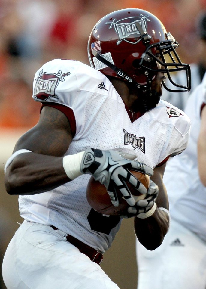 Photo - Troy's Jerrel Jernigan (3) runs up field during the college football game between the Oklahoma State University Cowboys (OSU) and the Troy University Trojans at Boone Pickens Stadium in Stillwater, Okla., Saturday, Sept. 11, 2010. Photo by Sarah Phipps, The Oklahoman