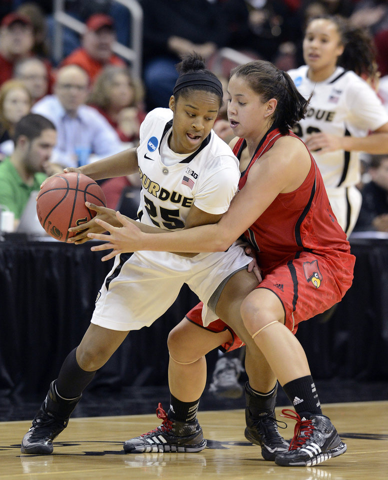 Purdue's April Wilson, Left, attempts to keep the ball away from Louisville's Shoni Schimmel during the first half of their second round game in the women's NCAA college basketball tournament in Louisville, Ky., Tuesday March 26, 2013. (AP Photo/Timothy D. Easley)