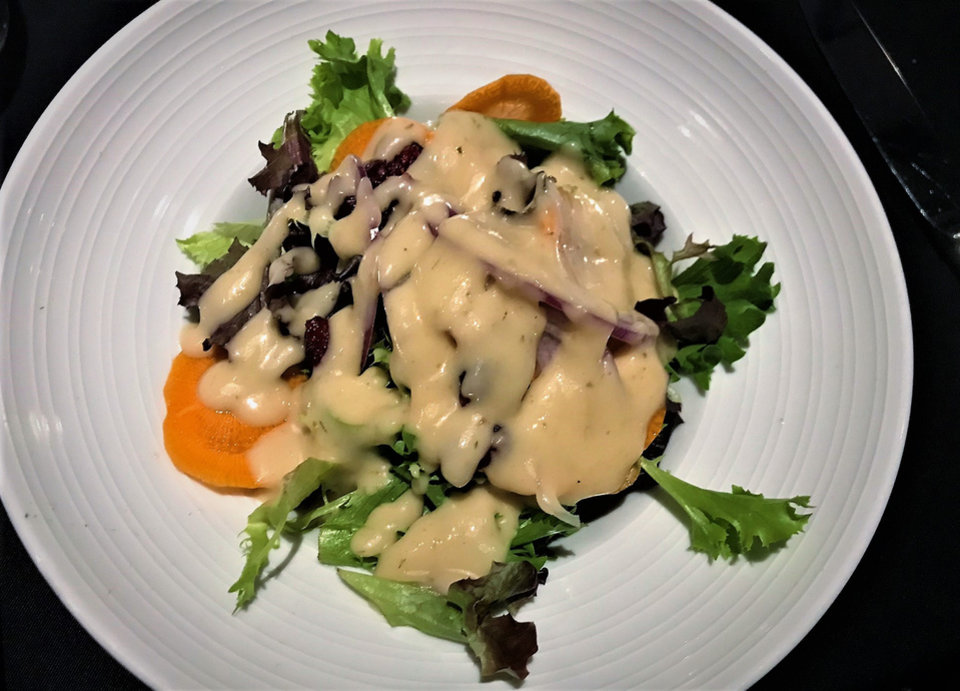 Photo -  The Bibb Lettuce Salad from The Union Wood-Fired Grill in Oklahoma City. [Photo by Dave Cathey, The Oklahoman]