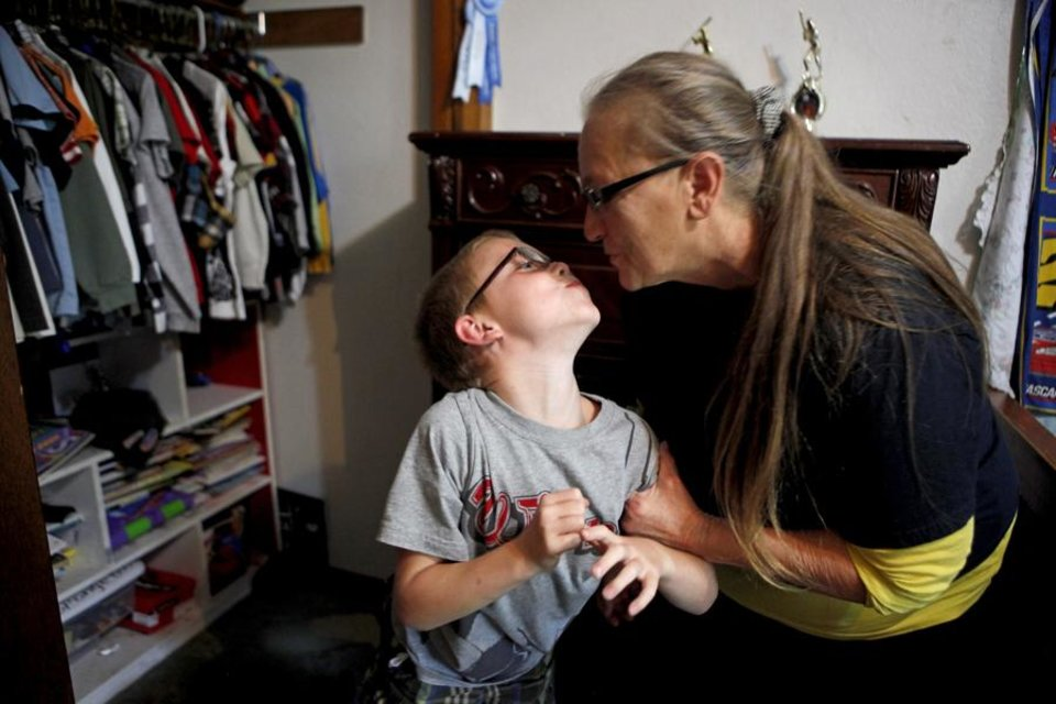 Photo -  GRANDPARENTS: Yvonne Underhill kisses her grandson Jeremy Underhill, 7, after school in their Choctaw, Okla., home on Thursday, September 9, 2010.  Photo by Bryan Terry, The Oklahoman ORG XMIT: KOD