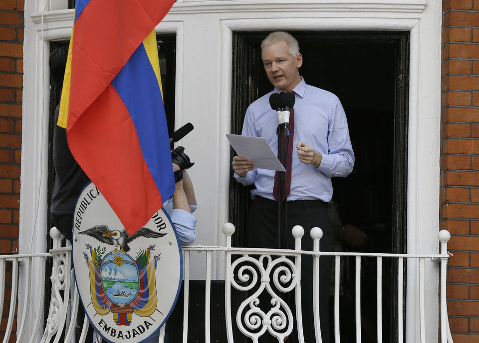 Photo -   Julian Assange, founder of WikiLeaks makes a statement from a balcony of the Equador Embassy in London, Sunday, Aug. 19, 2012. Assange called on United States President Barack Obama to end a