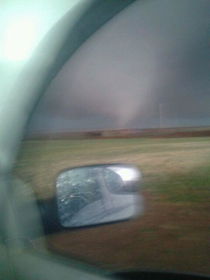 Photo - Amateur tornado chaser Richard Charles Henderson sent this cellphone photo of a tornado to a friend minutes before the tornado killed him. The friend, George