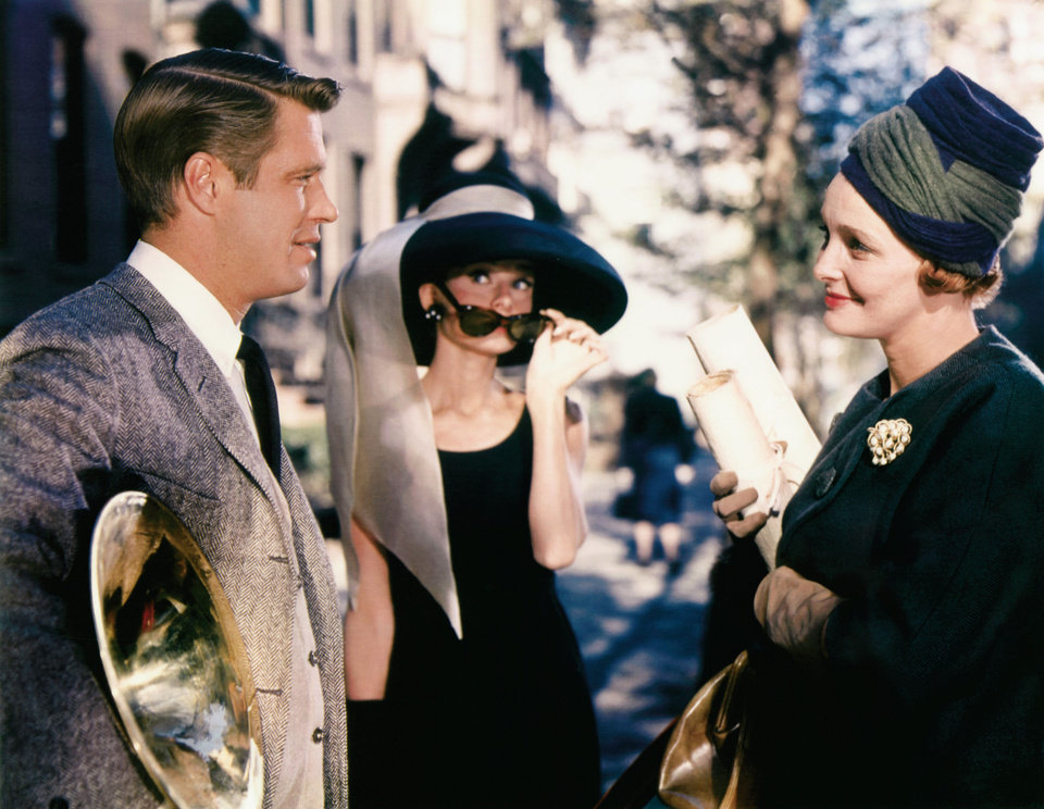 Photo - In this image released by Paramount Pictures, George Peppard, left, Audrey Hepburn and Patricia Neal, right, are shown in a scene from,