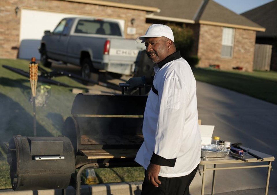 Terry Williams cooks burgers and hotdogs during a National Night Out event at the JFK Neighborhood in Oklahoma City, Tuesday, Sept. 11, 2012.  Photo by Garett Fisbeck, The Oklahoman