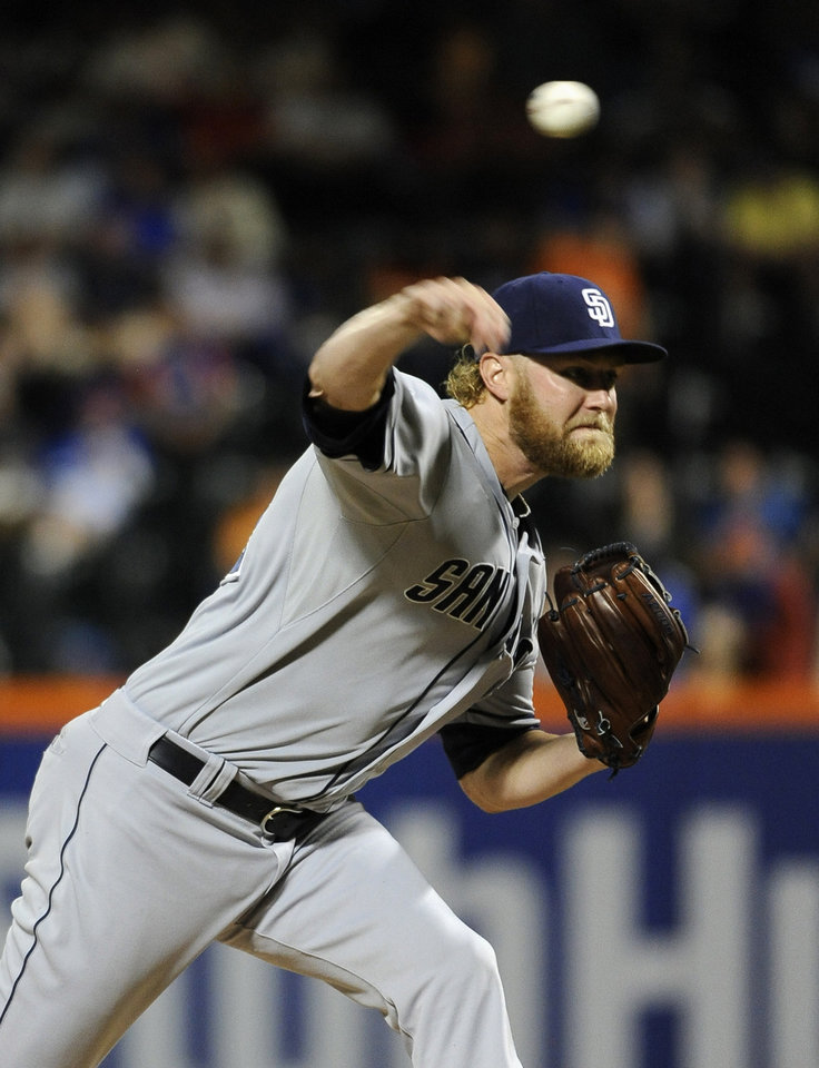 Photo - San Diego Padres starter Andrew Cashner pitches against the New York Mets in the first inning of a baseball game at Citi Field on Friday, June 13, 2014, in New York. (AP Photo/Kathy Kmonicek)