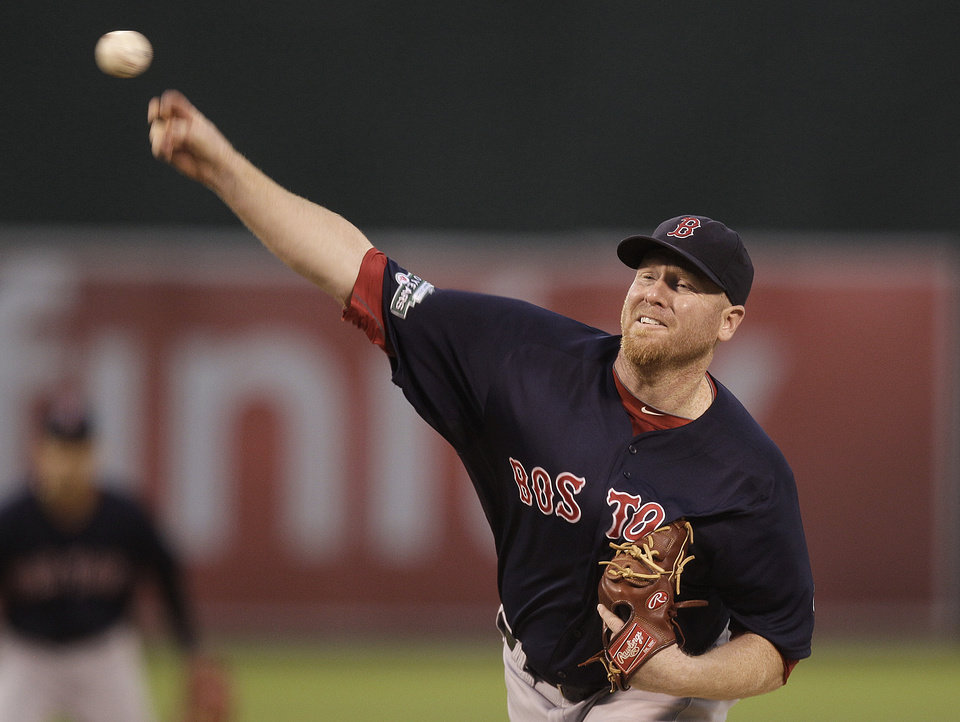 Photo -   Boston Red Sox's Aaron Cook works against the Oakland Athletics in the first inning of a baseball game Friday, Aug. 31, 2012, in Oakland, Calif. (AP Photo/Ben Margot)