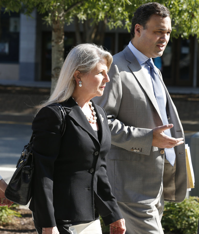 Photo - Former Virginia first lady Maureen McDonnell arrives at federal court with her attorney William Burck in Richmond, Va., Thursday, Aug. 21, 2014. Former Gov. Bob McDonnell took the stand in his own defense on Wednesday and is expected to continue Thursday. (AP Photo/Steve Helber)