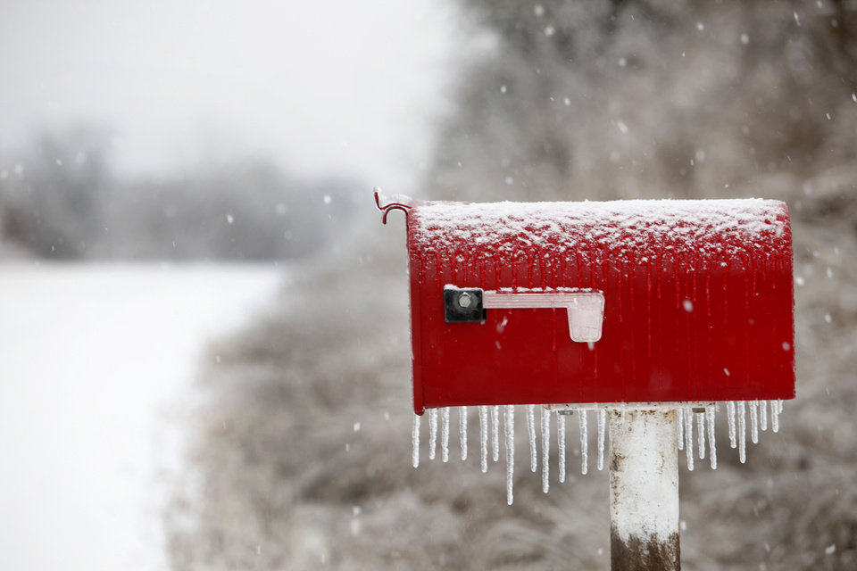 Photo - A mail box is covered with ice on Pine road in Logan County, Oklahoma January 29, 2010. Photo by Steve Gooch, The Oklahoman