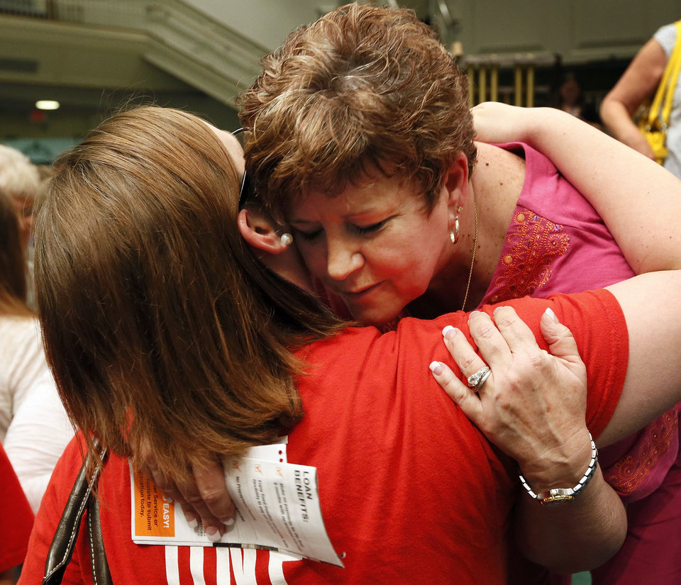 Moore Superintendent Susan Pierce gets a hug from Kingsgate Elementary teacher Jessica Parker after a district staff meeting Wednesday afternoon at Southern Hills Baptist Church. Pierce is retiring and will spend her last weeks at work helping the district begin the rebuilding process after a tornado killed seven students. <strong>NATE BILLINGS - THE OKLAHOMAN</strong>