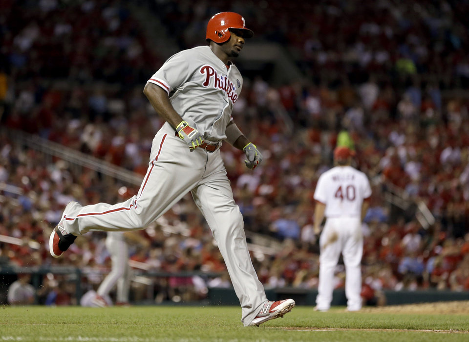 Photo - Philadelphia Phillies' Ryan Howard, left, rounds the bases after hitting a two-run home run during the sixth inning of a baseball game against the St. Louis Cardinals, Thursday, June 19, 2014, in St. Louis. (AP Photo/Jeff Roberson)