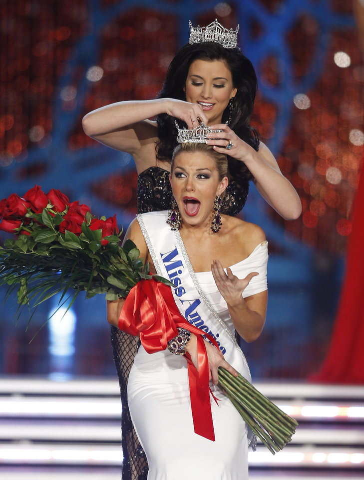 Photo - Miss New York Mallory Hagan is crowned Miss America 2013 by Miss America 2012 Laura Kaeppeler on Saturday, Jan. 12, 2013, in Las Vegas. (AP Photo/Isaac Brekken)