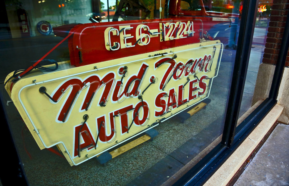 MidTown Auto Sales sign on the ground floor at 1100 N. Broadway on Monday, Aug. 5, 2013 in Oklahoma City, Okla.    Photo by Chris Landsberger, The Oklahoman