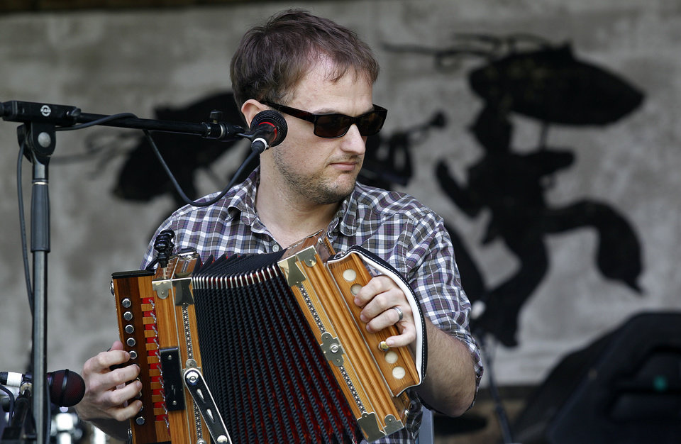 Photo - Cajun accordion player Drew Simon of the band T'Monde, plays at  the Fais Do Do Stage during the New Orleans Jazz and Heritage Festival in New Orleans, Friday, April 26, 2013. The Cajun band opened the annual festival. (AP Photo/Doug Parker)