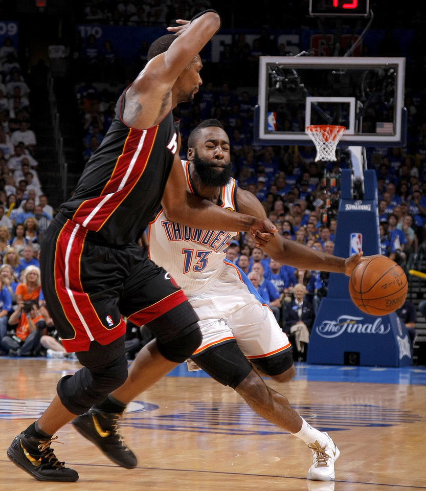 Oklahoma City's James Harden (13) tries to get past Miami's Chris Bosh (1) during Game 2 of the NBA Finals between the Oklahoma City Thunder and the Miami Heat at Chesapeake Energy Arena in Oklahoma City, Thursday, June 14, 2012. Photo by Sarah Phipps, The Oklahoman