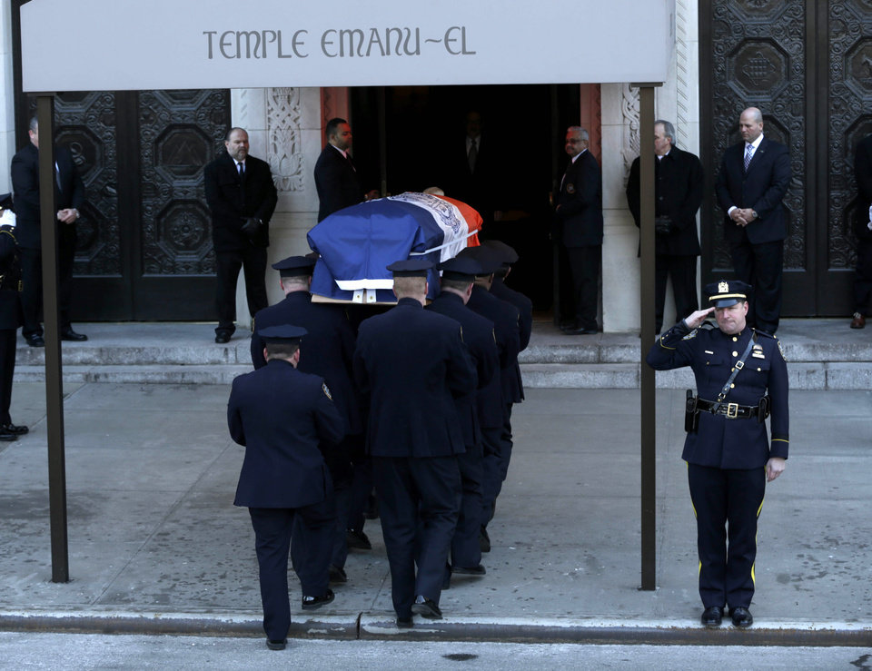 The casket containing the body of former New York City Mayor Ed Koch is brought into Temple Emanu-El for his funeral in New York, Monday, Feb. 4, 2013.  Koch died Friday of congestive heart failure at age 88.  (AP Photo/Seth Wenig)
