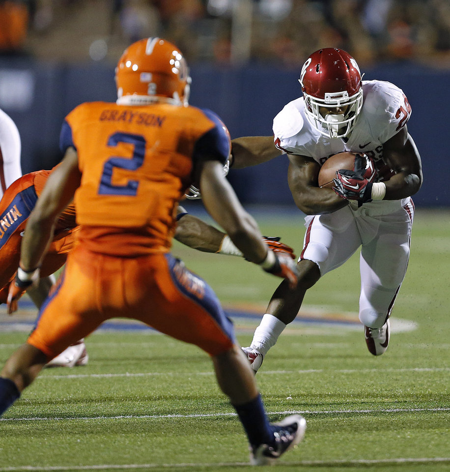 Photo - Oklahoma Sooners running back Brennan Clay (24) tries to get past UTEP's DeShawn Grayson (2) during the college football game between the University of Oklahoma Sooners (OU) and the University of Texas El Paso Miners (UTEP) at Sun Bowl Stadium on Saturday, Sept. 1, 2012, in El Paso, Tex.  Photo by Chris Landsberger, The Oklahoman