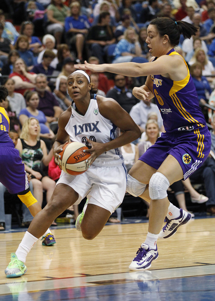 Photo - Minnesota Lynx guard Monica Wright (22) drives the ball around Los Angeles Sparks guard Jenna O'Hea (6) in the second half of a WNBA basketball game, Friday, June 28, 2013, in Minneapolis. The Lynx won 88-64. (AP Photo/Stacy Bengs) ORG XMIT: MNSB112