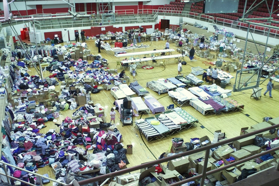 Tornado relief: Del City High School Gym filling up with donated supplies and beds for the homeless.