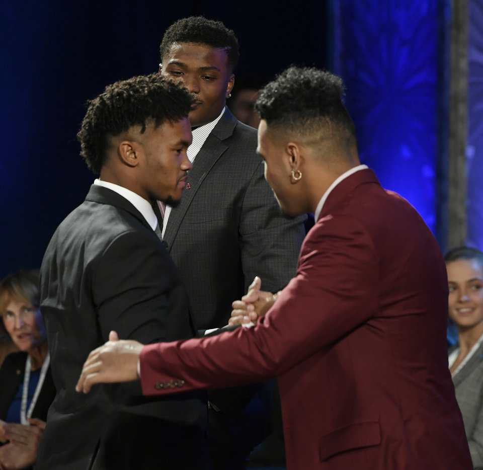 Photo - CORRECTS TO OKLAHOMA, INSTEAD OF OKLAHOMA STATE - Oklahoma quarterback Kyler Murray, left, is congratulated by Alabama's Tua Tagovailoa after Murray won the Heisman Trophy on Saturday, Dec. 8, 2018 in New York. (Todd J. Van Emst/Heisman Trophy Trust via AP, Pool)