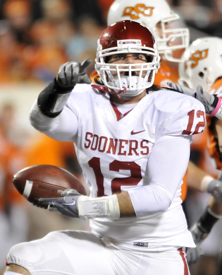 Photo - Oklahoma's Austin Box points to the OU fans after intercepting a deflected pass against Oklahoma State Saturday November 27, 2010 at Boone Pickens Stadium. (AP Photo/Enid News & Eagle, Billy Hefton)