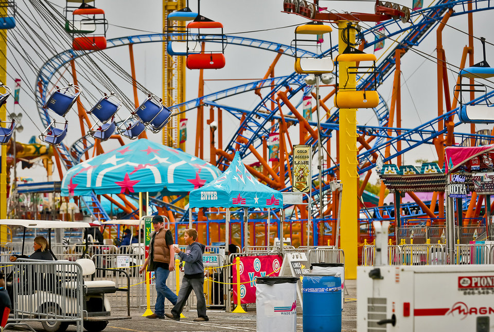 Photo - Visitors walk the midway at the Oklahoma State Fair at State Fair Park on Friday, Sept. 14, 2012, in Oklahoma City, Oklahoma.  Photo by Chris Landsberger, The Oklahoman
