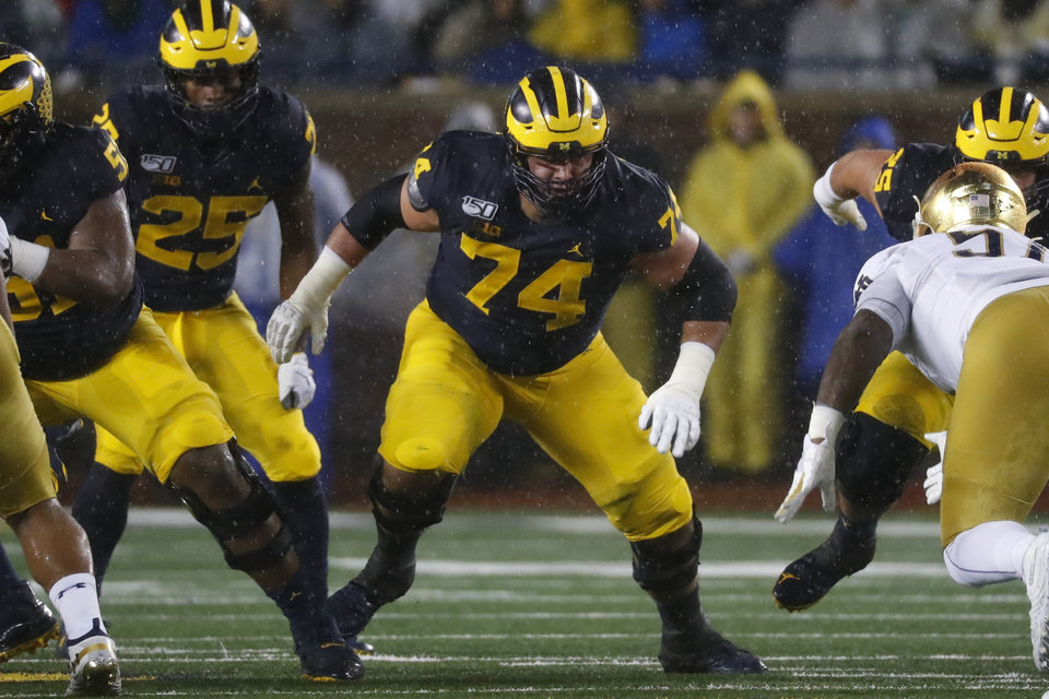Photo - FILE - In this Oct. 26, 2019, file photo, Michigan offensive lineman Ben Bredeson (74) plays against Notre Dame in the first half of an NCAA college football game in Ann Arbor, Mich. In their quest to keep quarterback Lamar Jackson upright and running, the Baltimore Ravens have put a priority on fortifying their offensive line following the retirement of eight-time Pro Bowl guard Marshal Yanda. The Ravens took Bredeson with a fourth round pick at the 2020 NFL Draft. (AP Photo/Paul Sancya, File)