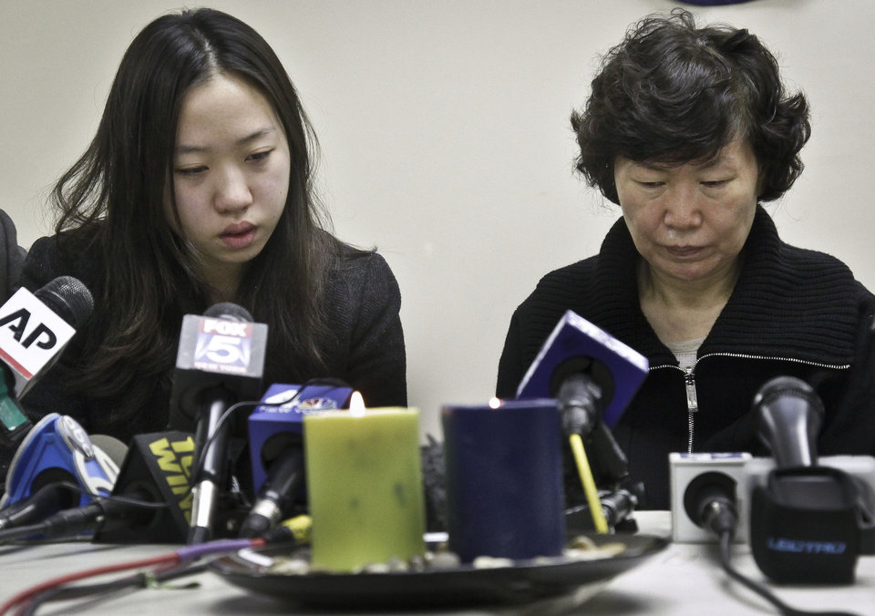Ashley Han, 20, sits next to her mother Serim Han, as she talks about her father Ki-Suck Han during a news conference on Wednesday, Dec. 5, 2012 in New York. Naeem Davis, 30, was taken into custody for questioning Tuesday after security video showed a man fitting the suspect\'s description working with street vendors near Rockefeller Center. Police said Davis made statements implicating himself in Ki-Suck Han's death. Witnesses told investigators they saw a man talking to himself Monday afternoon before he approached the 58-year-old Han of Queens at the Times Square station, got into an altercation with him and pushed him into the train\'s path.(AP Photo/Bebeto Matthews)