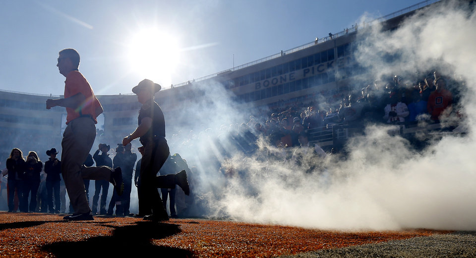 Photo - OSU coach Mike Gundy takes the field before a college football game between Oklahoma State University (OSU) and Texas Tech University (TTU) at Boone Pickens Stadium in Stillwater, Okla., Saturday, Nov. 17, 2012.  Photo by Bryan Terry, The Oklahoman