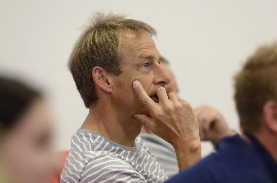 Photo - U.S. coach Jurgen Klinsmann watches a match between Brazil and Chile before a training session in Sao Paulo, Brazil, Saturday, June 28, 2014. The United States will play Belgium on Tuesday, in the round of 16 of soccer's World Cup. (AP Photo/Julio Cortez)