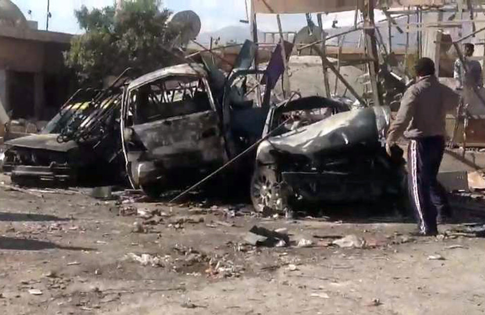 In this photo released by the Syrian official news agency SANA, Syrian citizens gather next to cars that were destroyed by a car bomb in Qatana, (25) kilometers (15 miles) southwest of Damascus, Syria, Thursday, Dec. 13, 2012. A bomb blast near a school in a Damascus suburb killed more than a dozen people, at least half of them women and children, the state news agency reported. Russia, Syria\'s most important international ally, said for the first time that President Bashar Assad is increasingly losing control and the opposition may win the civil war. (AP Photo/SANA) ORG XMIT: BEI108