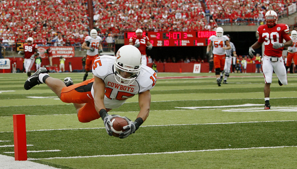 Seth Newton of OSU dives for a touchdown during  the college football game between Oklahoma State University (OSU) and the University of Nebraska at Memorial Stadium in Lincoln, Neb., on Saturday, Oct. 13, 2007. By Bryan Terry, The Oklahoman