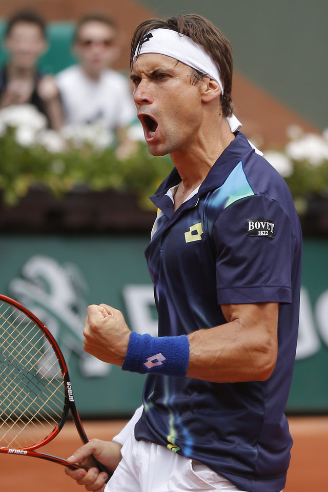 Photo - Spain's David Ferrer celebrates scoring a point during the fourth round match of the French Open tennis tournament against South Africa's Kevin Anderson at the Roland Garros stadium, in Paris, France, Monday, June 2, 2014.  (AP Photo/Michel Euler)